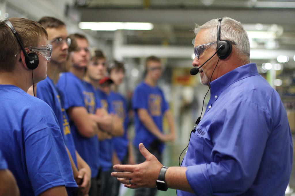 Students touring manufacturing company